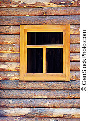 Wooden window of a timbered log hut.