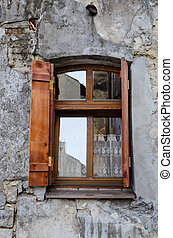 Wooden window on an old degraded wall