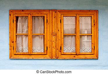 Wooden window on blue wall