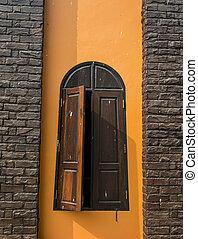 Wooden window on Orange wall