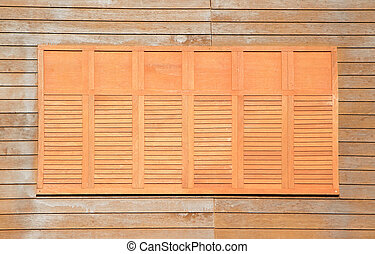 Wooden window on wooden wall