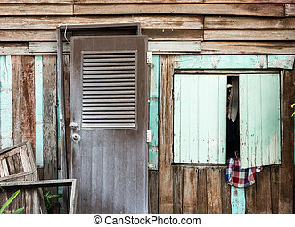 Wooden window on wooden wall, tropical house