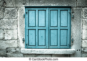Wooden window shutters. Closed old shuttered