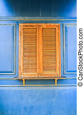 Wooden window with blue wall background