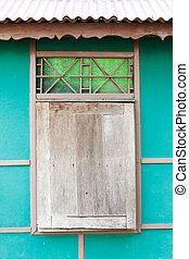Wooden window with green wall background