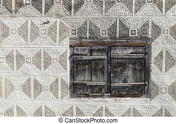Wooden window with grey graffito wall