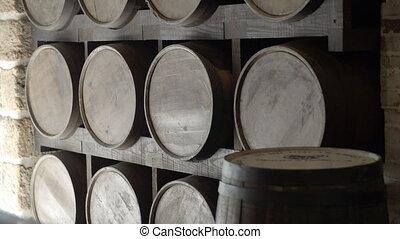 Wooden wine barrel - Many wooden wine barrels in a wine...