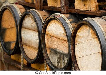 Wooden wine barrels - background .