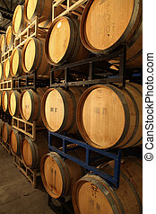 wine barrels - wooden wine barrels in a wine cellar