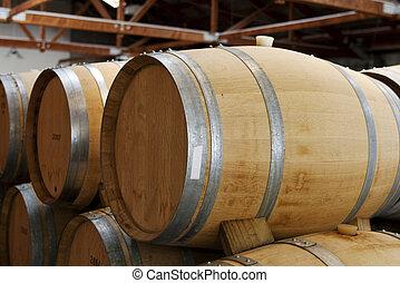 Wooden wine barrels - Row of wooden wine barrels