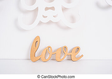 Wooden Word Love On A White Background In Studio