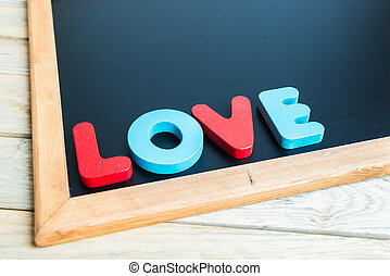 Wooden word LOVE on Black board