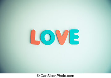 Wooden word LOVE on White background