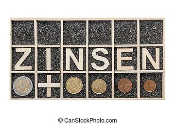 Wooden word ZINSEN in a box