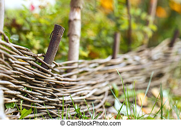 wooden woven fence outside nature