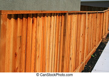 Wooden Yard Fence - Wooden yard fence next to a house.