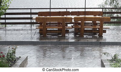 Woodens benchs - Weeping to rain wooden bench in park