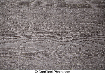 A texture of wood grain knot is shown close up.