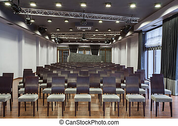 Woodland hotel - Conference hall with neatly arranged seats