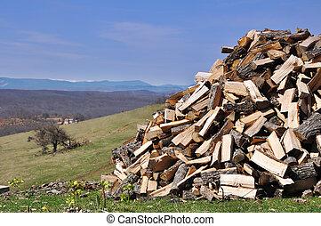 Woodpile on village panorama