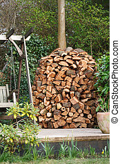 Woodpile - Circular wood stack or holz hausen with oak...