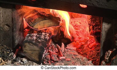 Woods burning in a fireplace - A still close up shot of some...