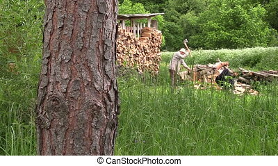 man chop wood - Woodshed and farmer worker man chop wood....