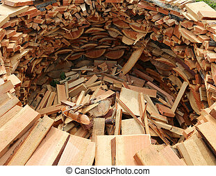 woodshed circular shape with many logs of wood cut