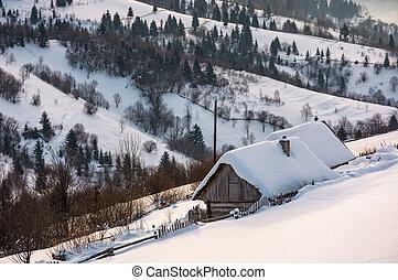 woodshed on hillside in deep snow. beautiful winter rural...
