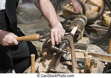Woodturning - A craftsman turning wood on a lathe