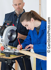 woodworker and female apprentice