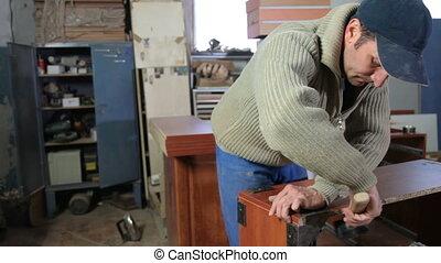 Woodworker assembling furniture in workshop