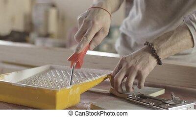 Woodworker dye varnish long wooden board by production...