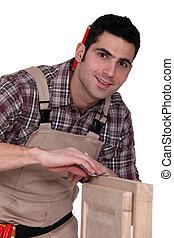 woodworker finishing a window frame