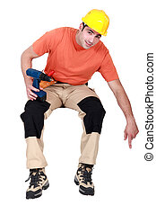 woodworker holding a drill