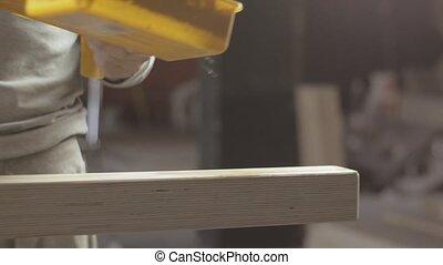 Woodworker paint varnish long wooden board by brush, roller. Manufacturer