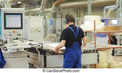 Woodworker preparing the machine