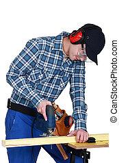 Woodworker using jigsaw
