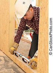 Woodworker using level spirit