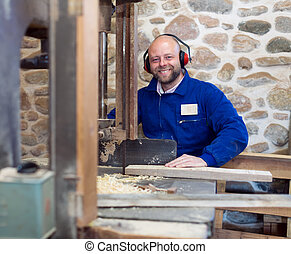 Woodworker working on a power-saw