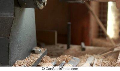Woodworking machine at carpentry workshop. Different ...