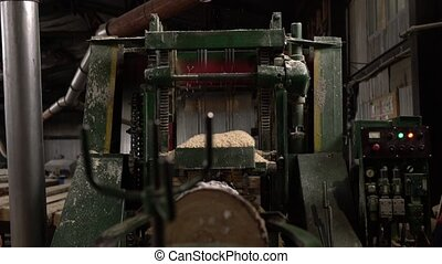 Woodworking shop. View of sawing machine running -...