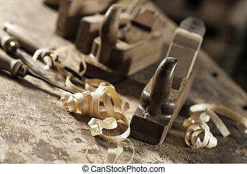 Wood planer and shavings at carpenters workshop