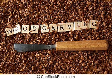 Woodworking word writen with letters on wood chips and chisel