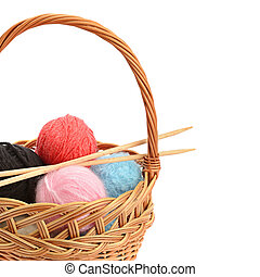 Wool balls in a basket isolated on a white background. Free space for text.