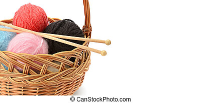 Wool balls in a basket isolated on a white background. Free space for text. Wide photo .