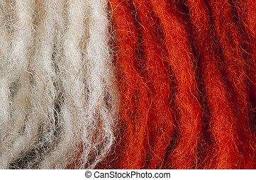 Wool fibers - White and red wool fibers closeup