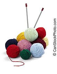 wool knitting needlecraft - close up of wool knitting on...