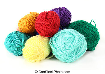 wool - colorful balls of wool on a white background