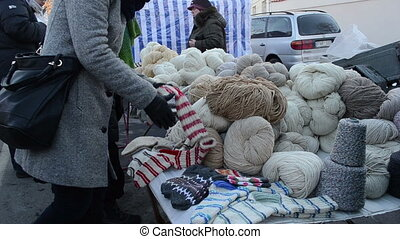 wool thread fair market - Woman pick various natural wool...